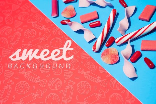 Süßer hintergrund mit süßigkeitsstöcken