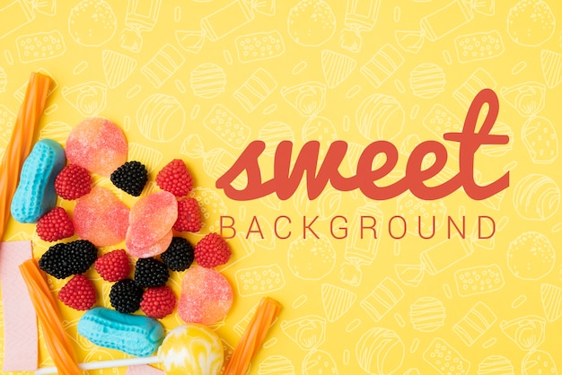 Süßer hintergrund mit zucker fällt mit gekritzeln