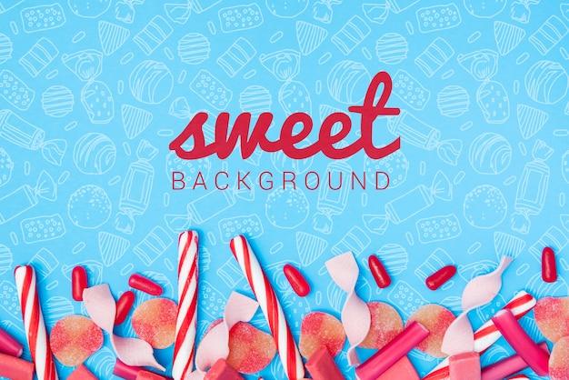 Süßer hintergrund mit zuckersüßigkeitsstöcken