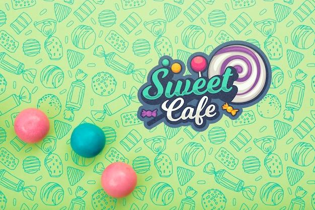 Süßes café mit lutscher und gummi