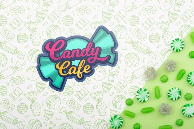Süßigkeitscafé und anordnung für grüne süßigkeiten und tropfen
