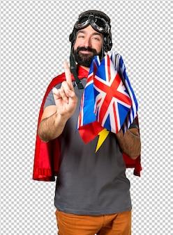 Superheld mit vielen flaggen, die einen zählen
