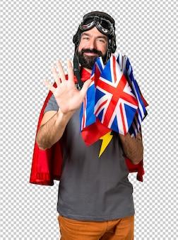 Superheld mit vielen flaggen, die fünf zählen