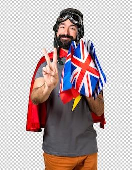 Superheld mit vielen flaggen, die zwei zählen