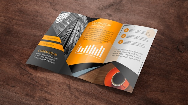 Trifold broschürenmodell auf holzoberfläche