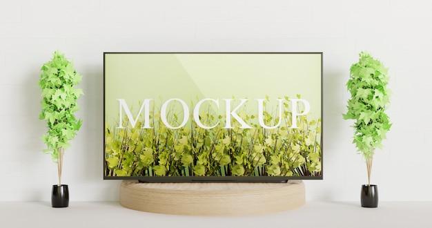 Tv-modell auf dem hölzernen podium zwischen paar dekorationspflanzen