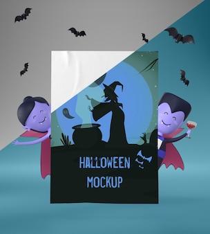 Vampire, die ein halloween-kartenmodell halten