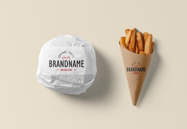 Verpackter burger mit chips, die isoliert rendern