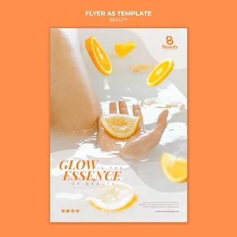 Vertikale flyer-vorlage für die home-spa-hautpflege mit frau und orangenscheiben