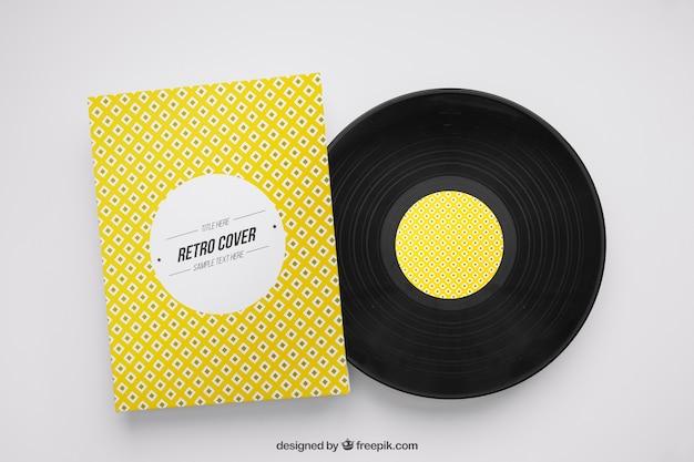Vinyl-modell und gelber flyer