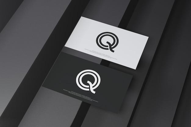Visitenkartenmodell auf schwarzem treppenhintergrund