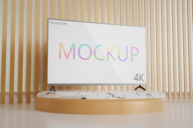 Vollfarbige tv-modell-seitenansicht, die auf dem weißen marmorbühnenpodest steht