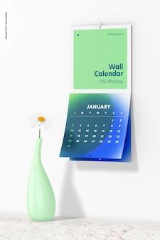 Wandkalender mit blumenvase mockup