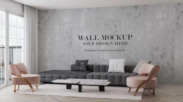 Wandmodell im innenraum mit rosa sesseln und grauem sofa