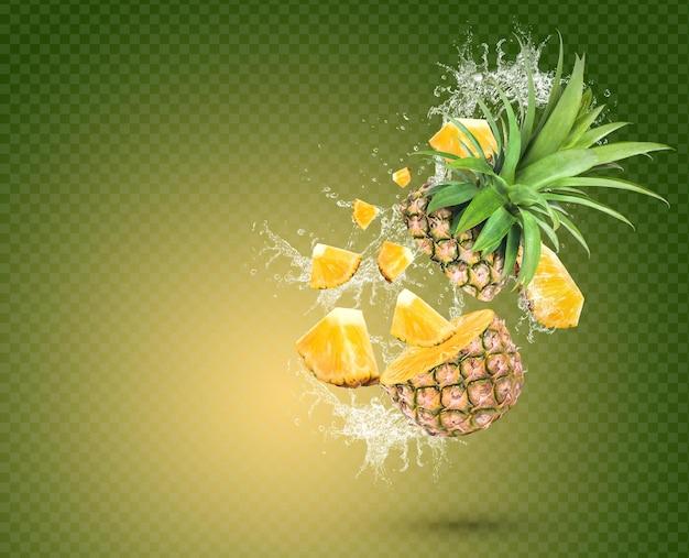 Wasserspritzer auf frischer ananas mit blättern auf grünem hintergrund premium psd