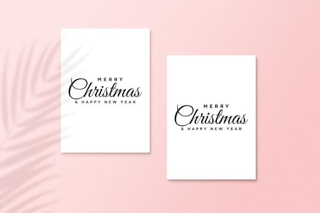 Weihnachtsgrußkartenmodell mit palmblattschatten