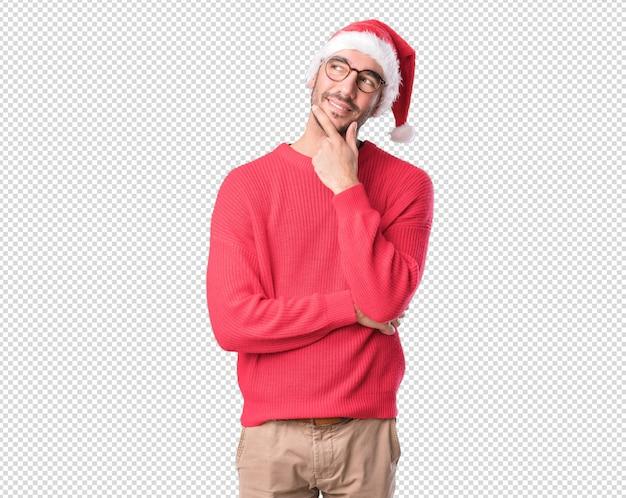 Weihnachtskonzepte - gestikulieren des jungen mannes