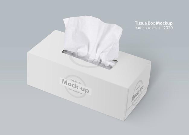 Weiße leere taschentuchbox auf grauem hintergrund mit gesichtstuch