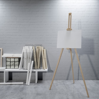 Weiße leinwand auf einer staffelei im kunstraum