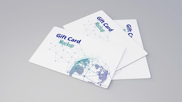 Weißes geschenkkarten-kreditkartenmodell, das auf grauem tisch stapelt