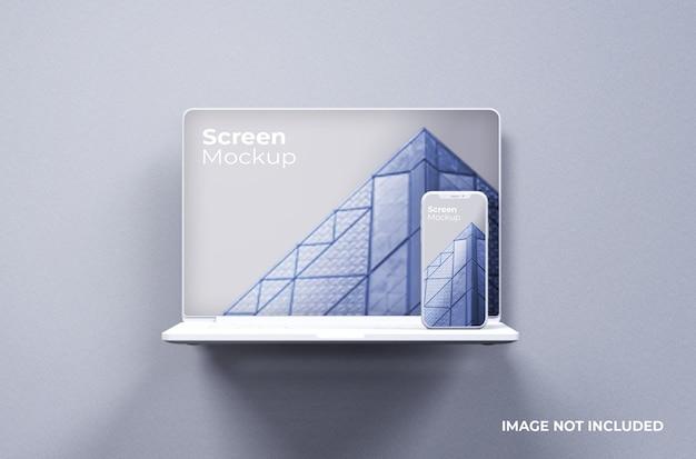 Weißes macbook pro clay mit vorderansicht des smartphone-modells