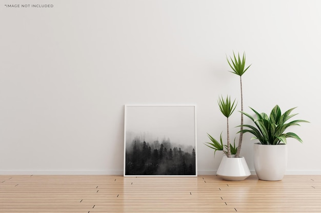 Weißes quadratisches fotorahmenmodell auf leerem raum der weißen wand mit pflanzen auf einem holzboden