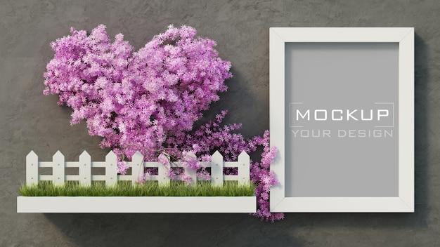 Weißes rahmenmodell auf betonwand mit rosa herzblumenbaum