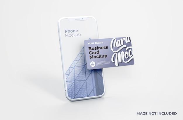 Weißes smartphone mit visitenkartenmodell