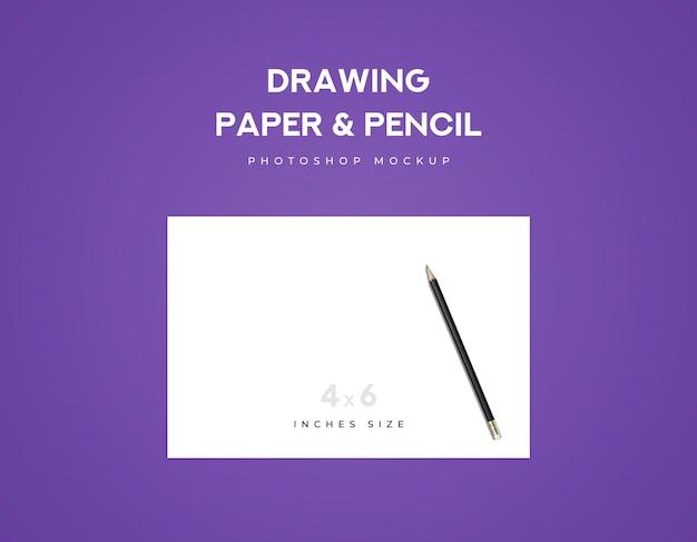 Zeichenpapier und schwarzer bleistift auf einem papier mit violettem hintergrund
