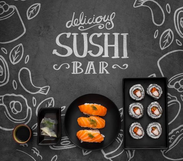 Zeichnen sie mit sushi und tablette, die mit sushirollen eingestellt werden