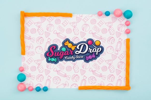 Zuckertropfen mit buntem süßigkeitsrahmen