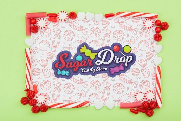 Zuckertropfen mit zuckerrahmen und gekritzelhintergrund
