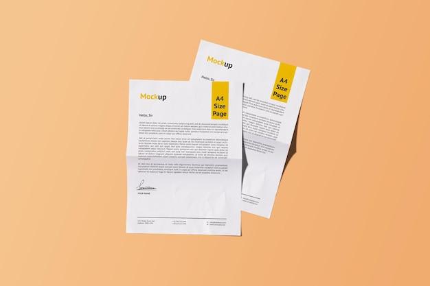 Zwei a4 realistic paper mockup design rendering isoliert