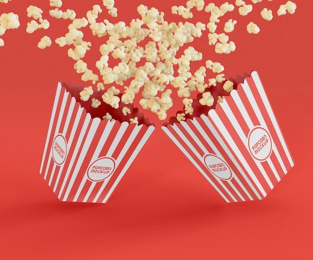 Zwei eimer mit popcorn-modell