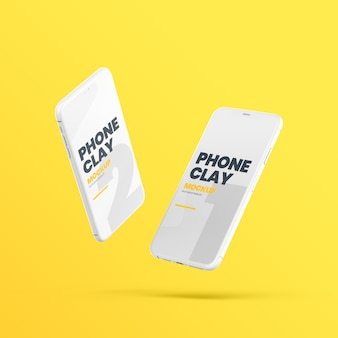 Zwei fliegende clay phone devices mockup