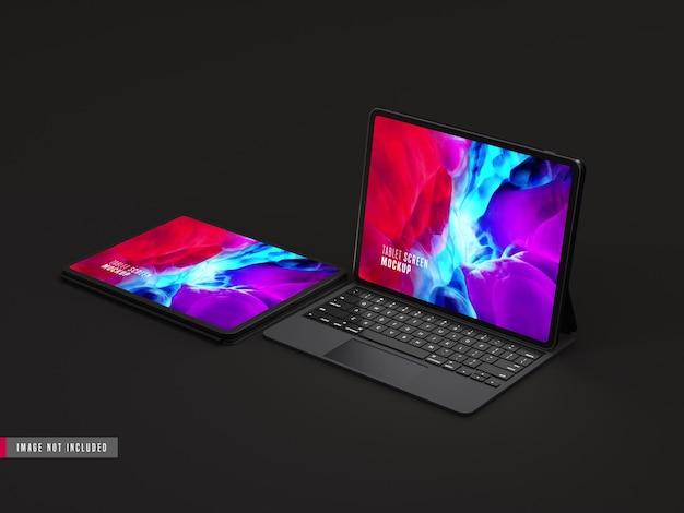 Zwei isolierte dunkle tablet pro-modell mit tastatur