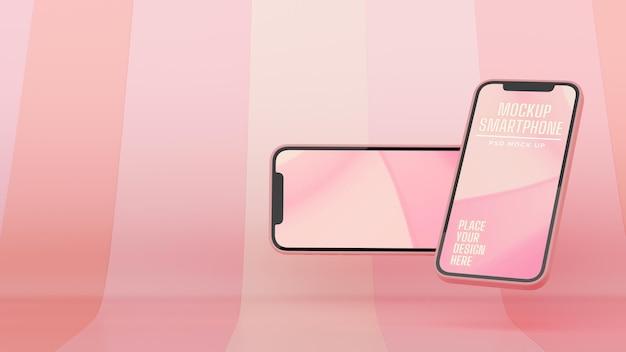 Zwei smartphones mit mockup-bildschirm, der auf rosa abstraktem hintergrund fliegt