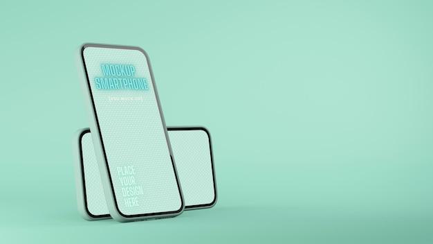 Zwei smartphones mit mockup-bildschirm isoliert auf mintgrünem hintergrund mit kopierraum