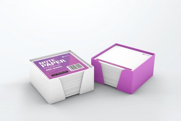 Zwei würfelhalter aus kunststoff mit papiermodell