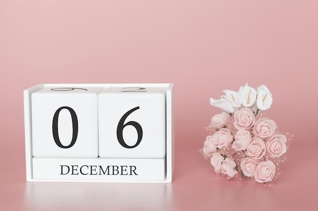 06 décembre. jour 6 du mois. cube de calendrier sur fond rose moderne, concept de commerce et événement important.
