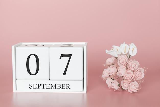 07 septembre. jour 7 du mois. cube de calendrier sur fond rose moderne, concept de commerce et événement important.