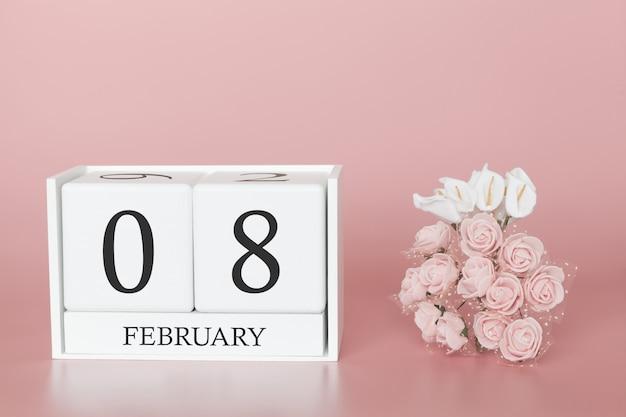 08 février. jour 8 du mois. cube de calendrier sur fond rose moderne, concept de commerce et événement important.