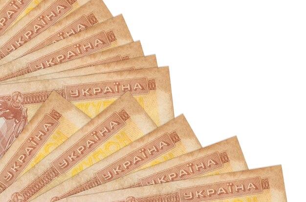 1 factures de coupon ukrainien se trouve isolé sur un mur blanc avec copie espace empilé dans le ventilateur se bouchent. concept de temps de paie ou opérations financières