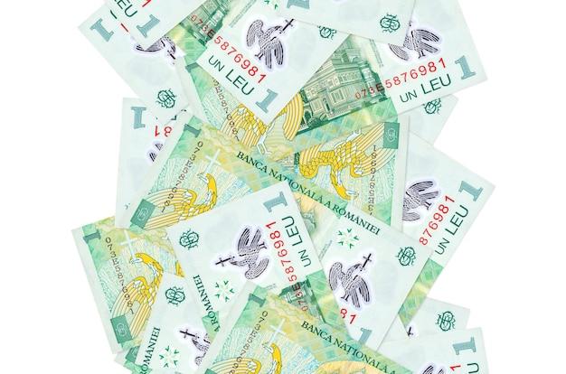 1 factures leu roumain volant vers le bas isolé sur blanc. de nombreux billets tombant avec espace copie blanche sur le côté gauche et droit