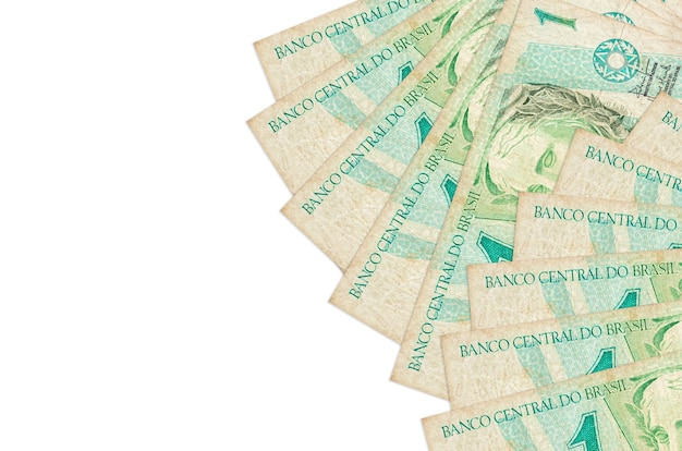 1 real brésilien factures se trouve isolé sur un mur blanc avec espace de copie. mur conceptuel de vie riche. grande quantité de richesse en monnaie nationale