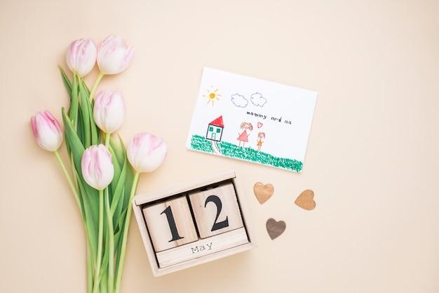 12 mai inscription avec dessin de mère et enfant