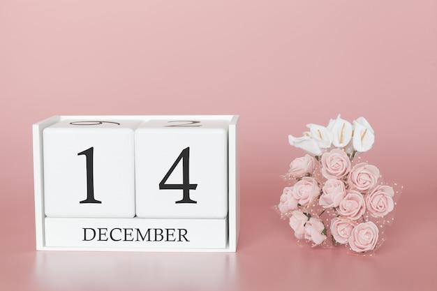 14 décembre. jour 14 du mois. cube de calendrier sur fond rose moderne, concept de commerce et événement important.