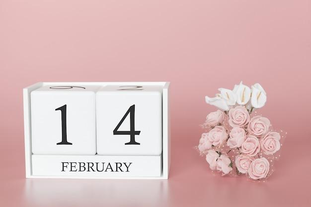 14 février. jour 14 du mois. cube de calendrier sur fond rose moderne, concept de commerce et événement important.