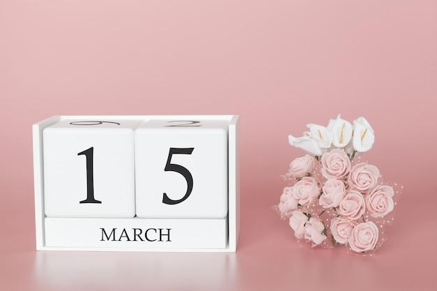 15 mars. jour 15 du mois. cube de calendrier sur rose moderne