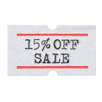 15 pour cent de réduction sur la vente imprimée avec une police de machine à écrire sur un autocollant d'étiquette de prix isolé